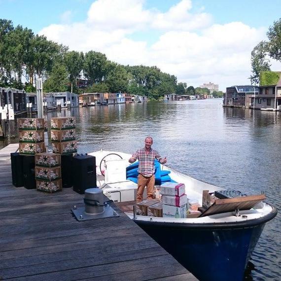 Grachtensloep met schipper voor een middag/avond op de grachten in Amsterdam